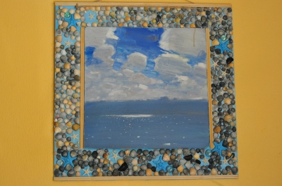 Frame of seashells and starfish